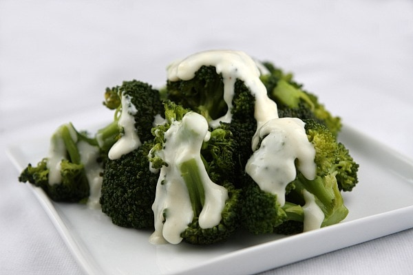 Fresh steamed broccoli topped with a Parmesan and Swiss cheese sauce