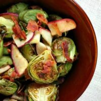 Brussels sprouts with bacon and apple in a bowl