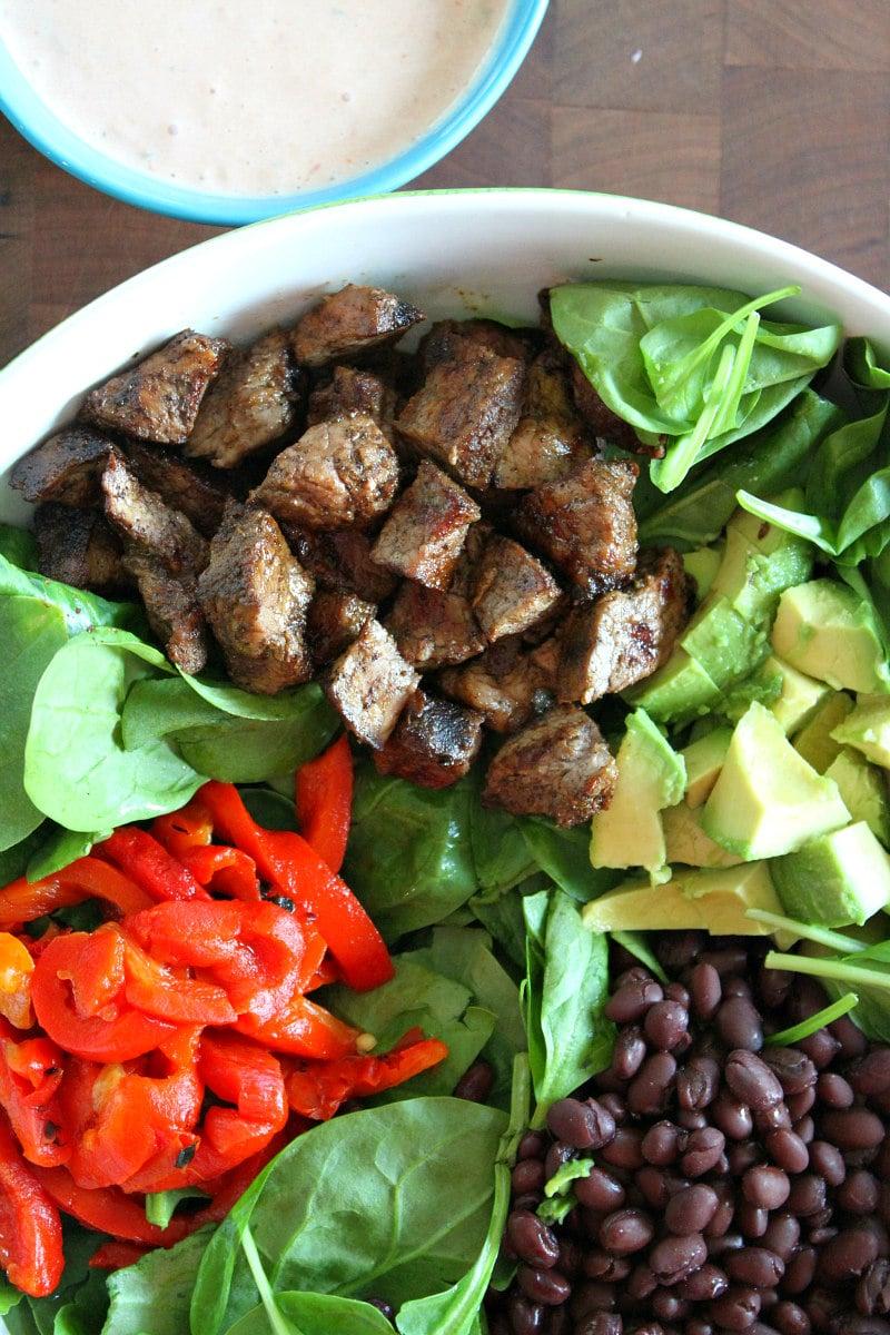 Blackened Steak Salad ingredients in bowl