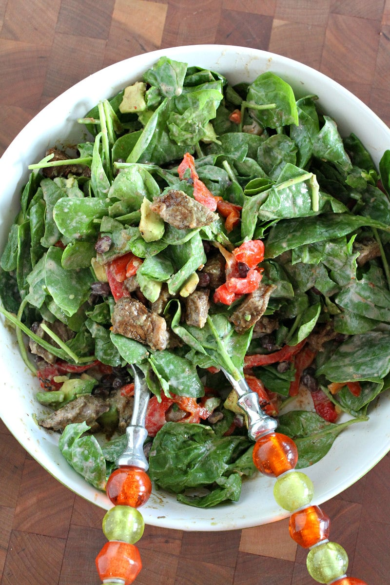 Blackened Steak Salad tossed with dressing and ready to serve