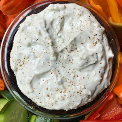 overhead shot of blue cheese dip surrounded by fresh cut vegetables