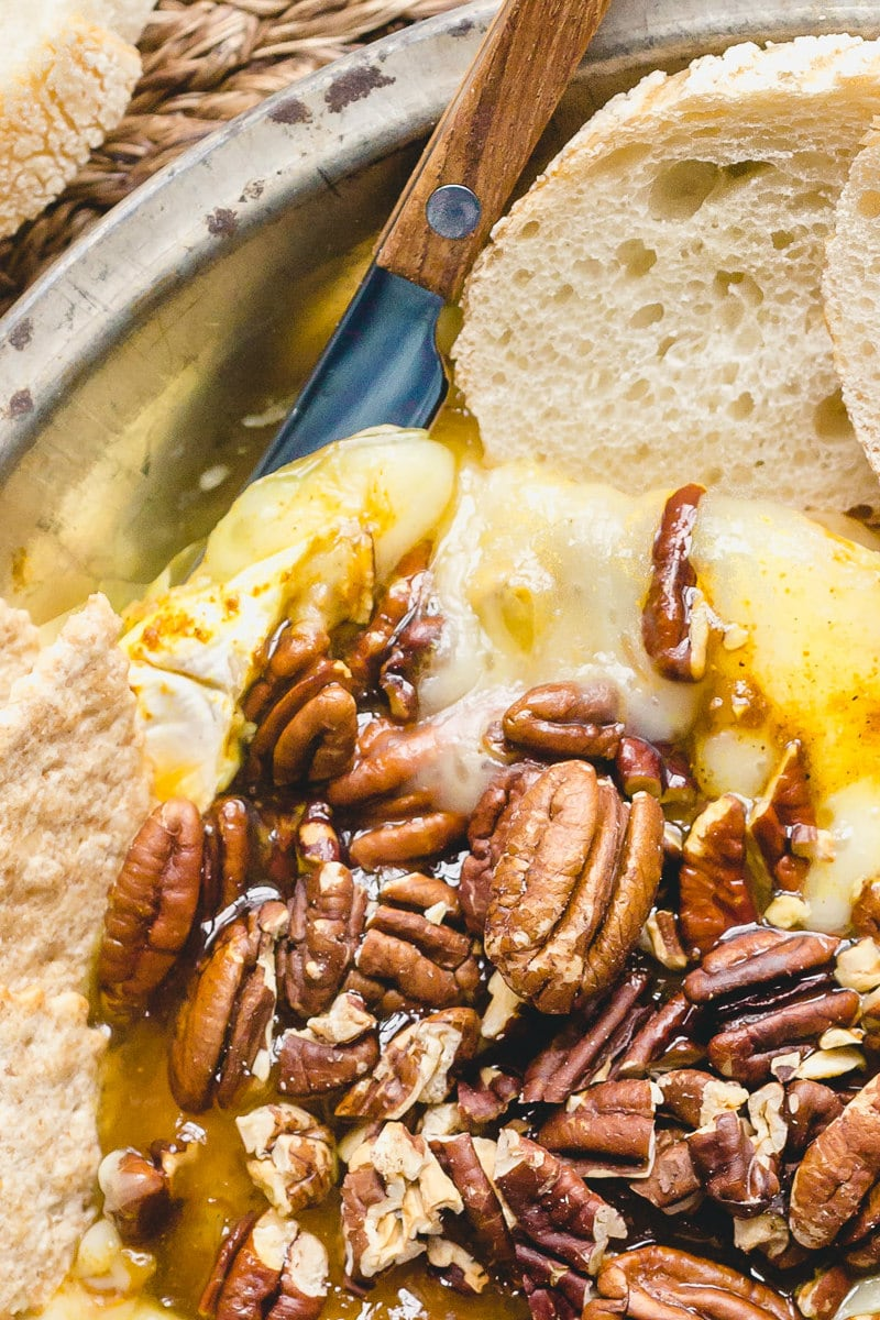 melted brie cheese and pecans with sliced baguette