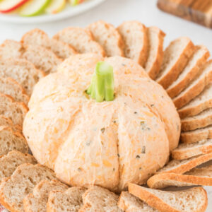 pumpkin cheese dip with baguette and apple