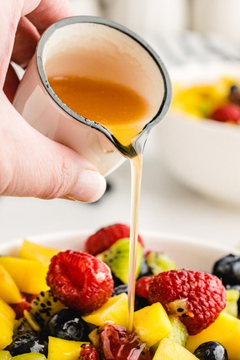 pour the vinaigrette over the fruit salsa