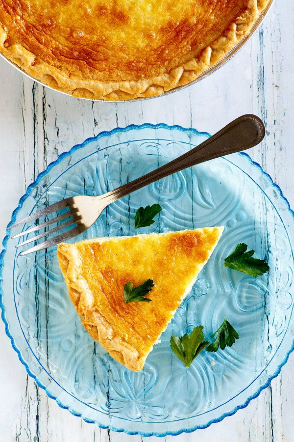 slice of quiche on a blue plate