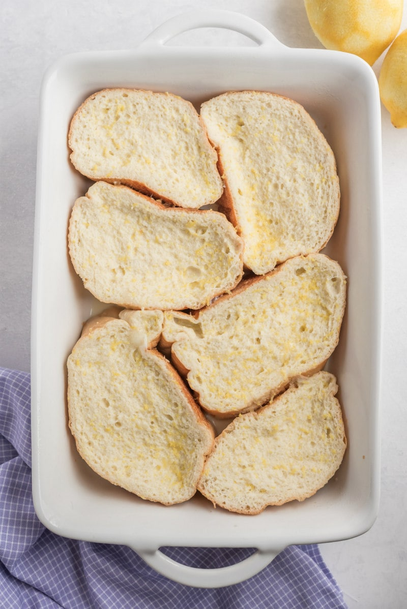 french bread dipped in egg custard and placed in white baking dish