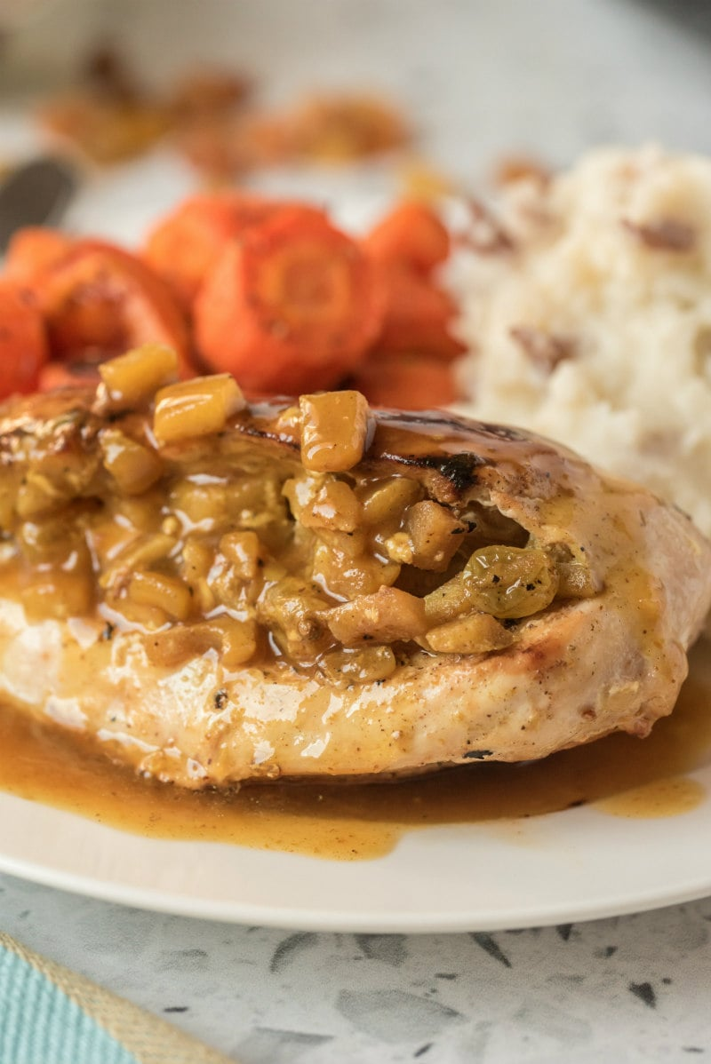 chicken with curried apple stuffing on plate