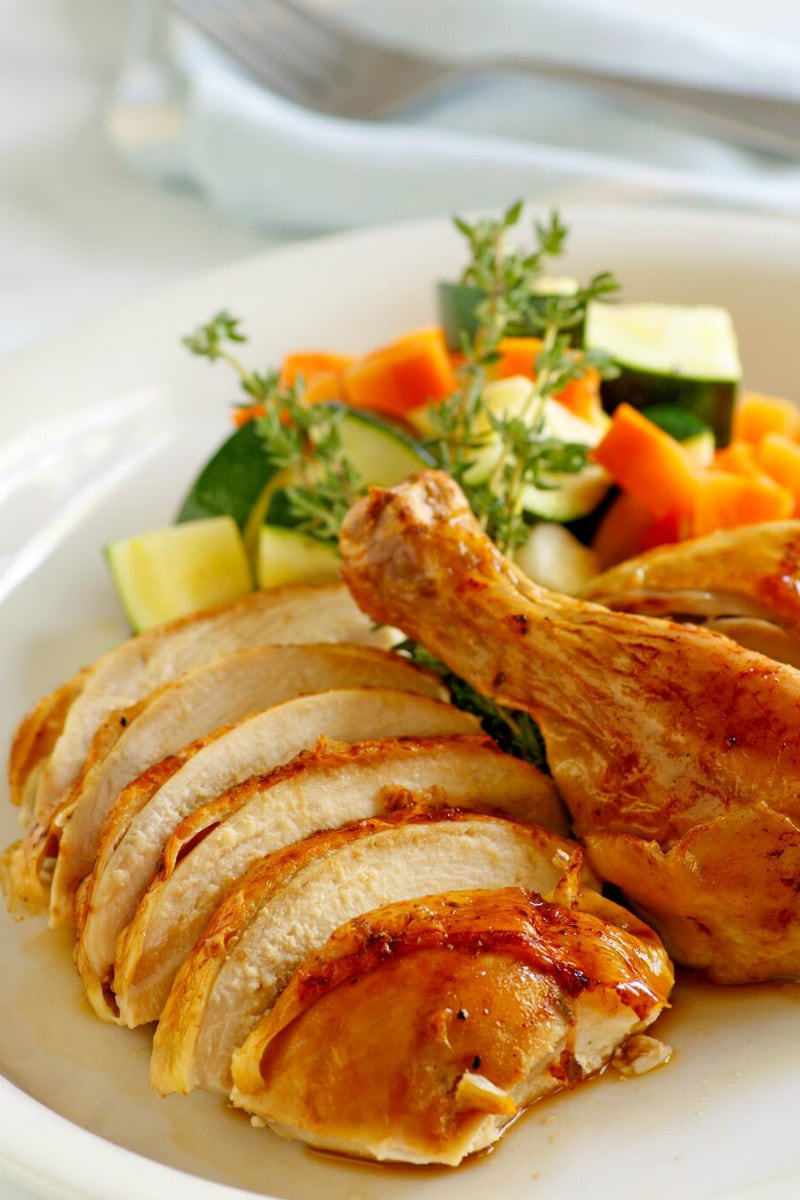 Cider Roasted Chicken carved on a platter with vegetables