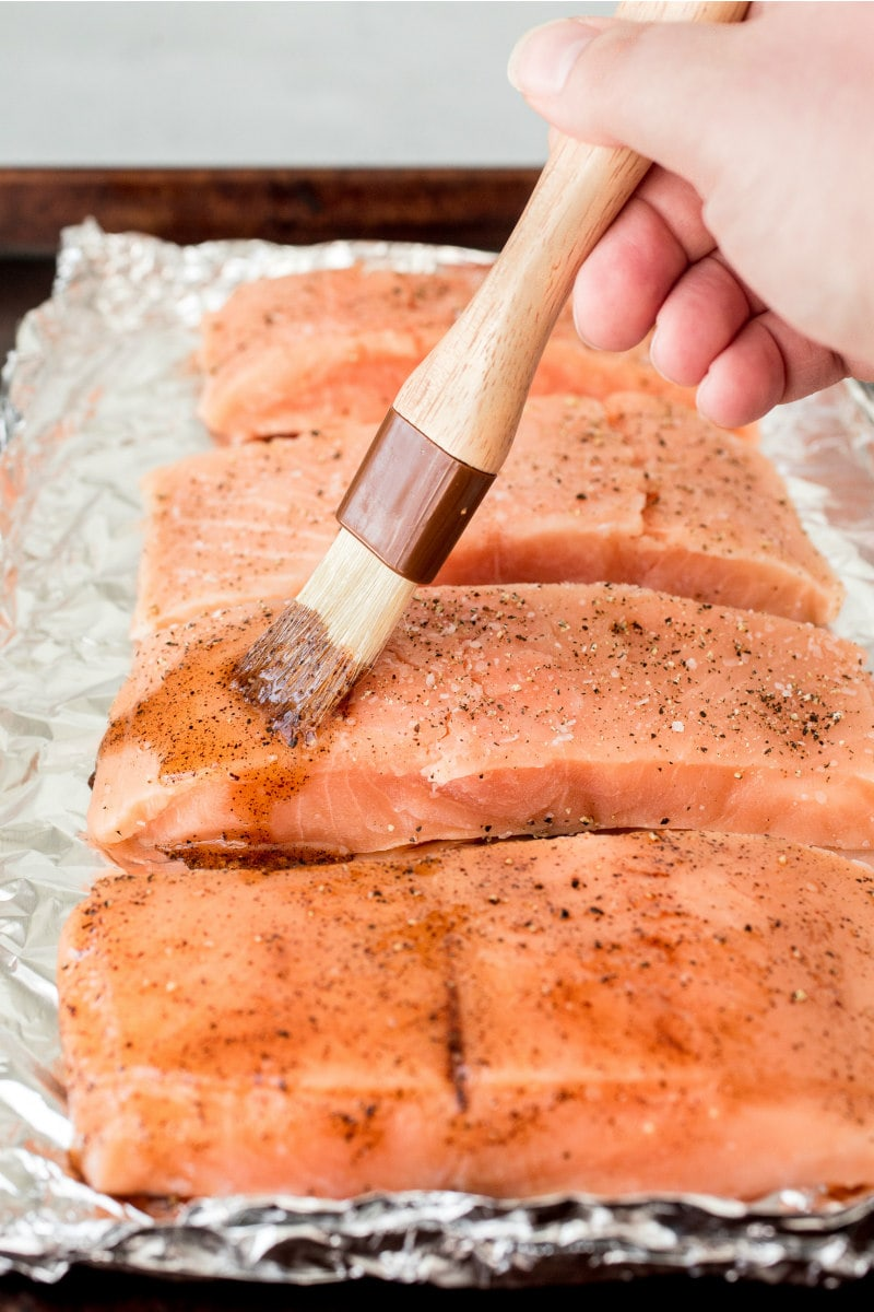 prepping salmon to bake