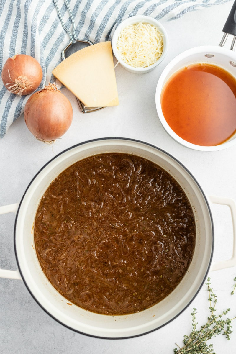showing process of making caramelized onion soup in soup pot