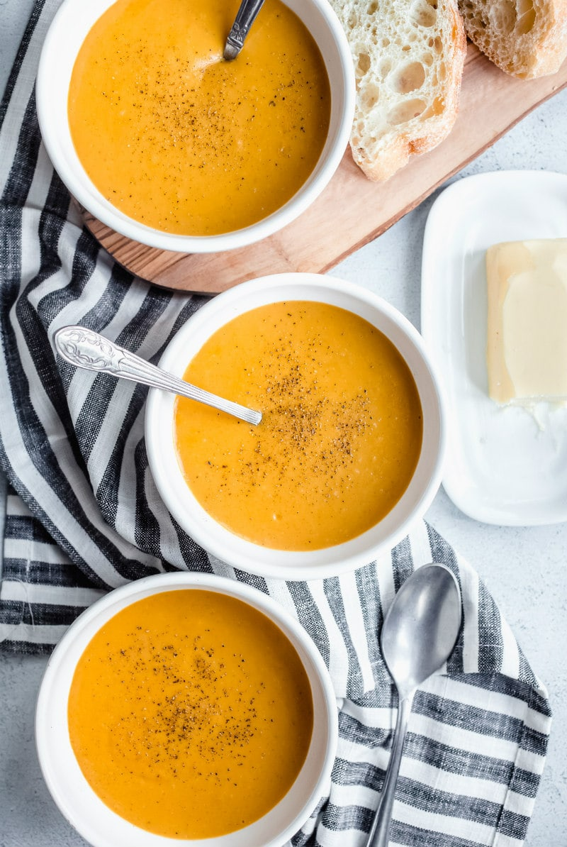 bowls of carrot and butternut squash soup
