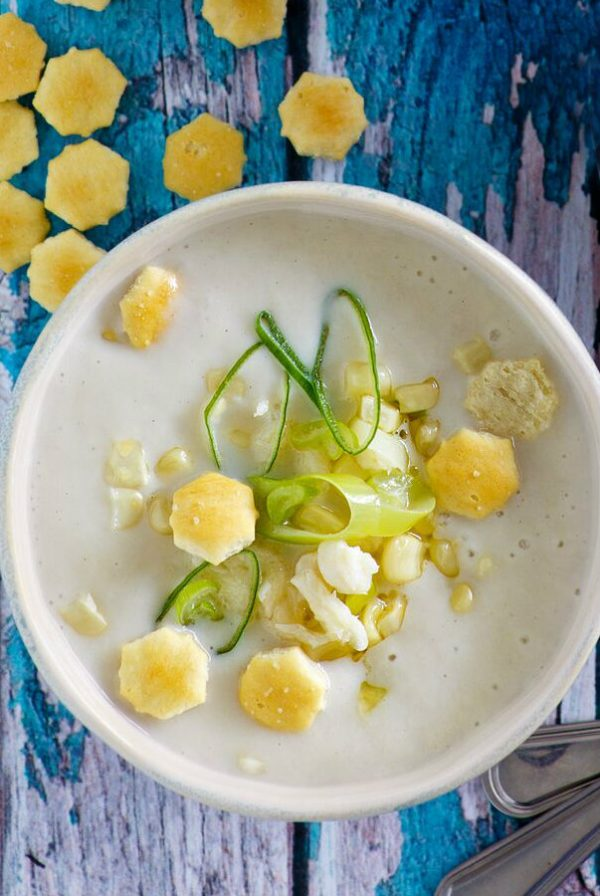Bowl of Corn and Crab Chowder garnished with oyster crackers