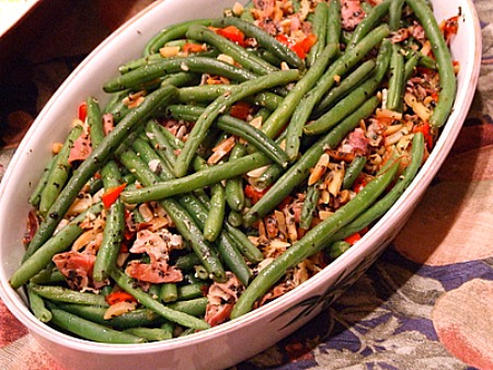 Garlic Green Beans with Prosciutto in a white casserole dish