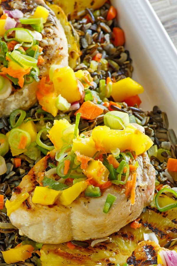 Grilled Swordfish topped with Mango Salsa in a white serving dish