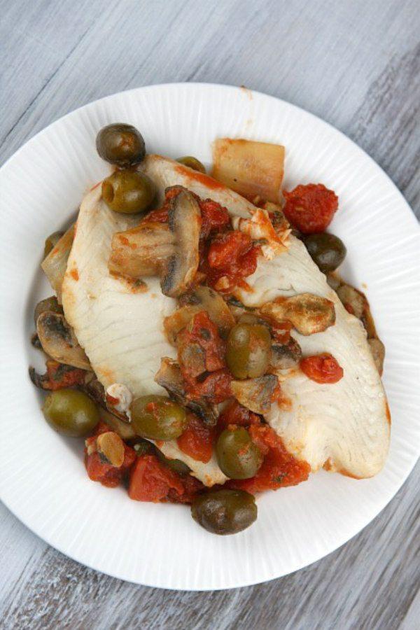 Tilapia with Olive, Mushroom and Tomato Sauce - recipe from RecipeGirl.com