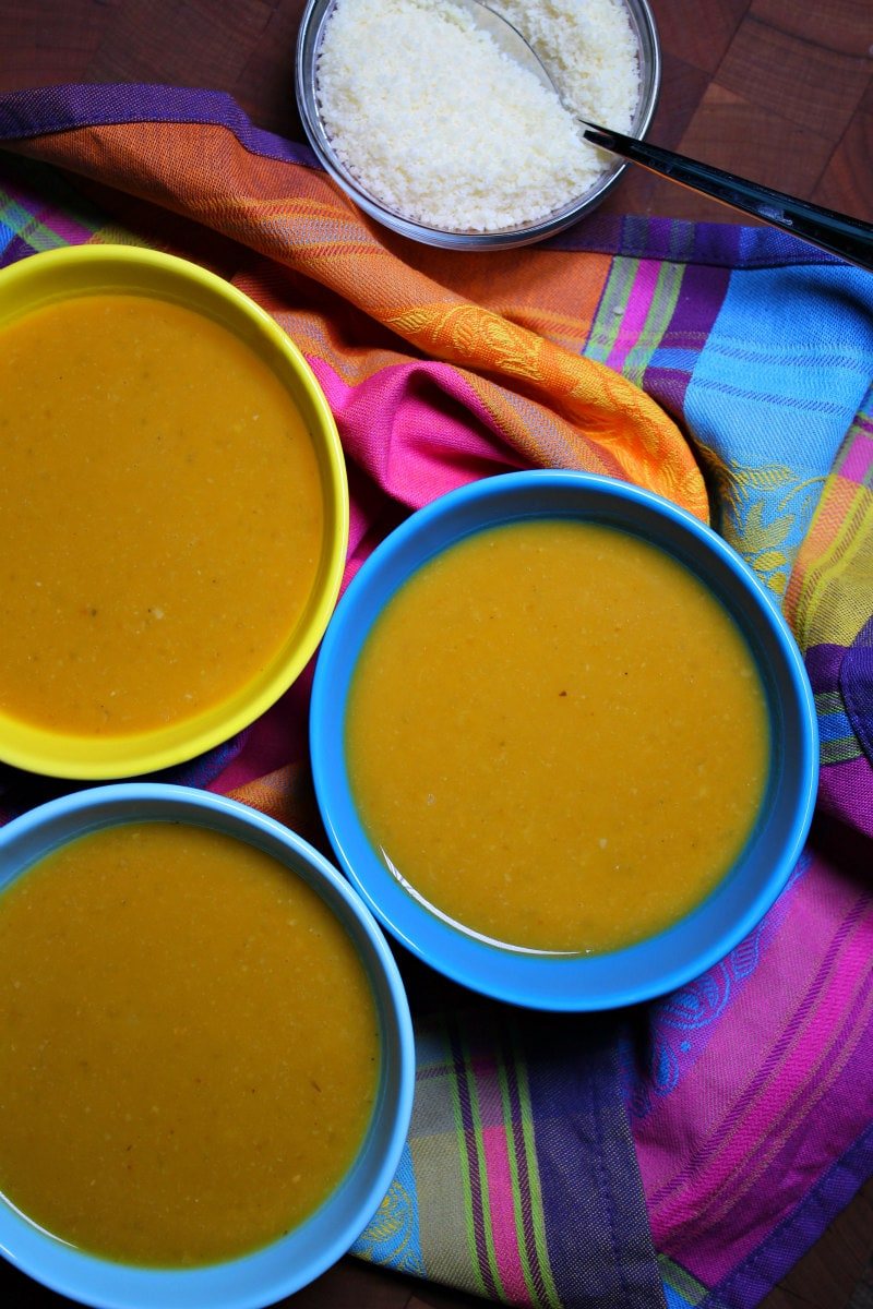 Tuscan Pumpkin White Bean Soup served with grated Parmesan cheese