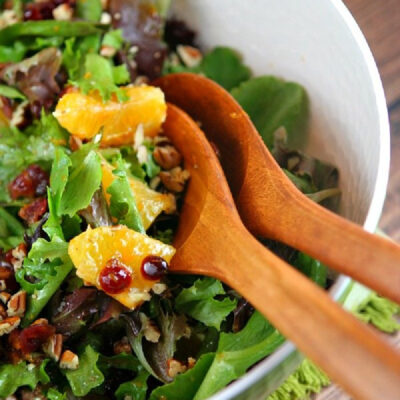 mixed green salad with oranges dried cranberries and pecans