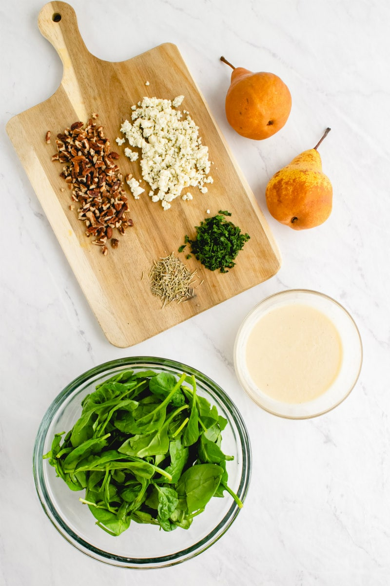 ingredients displayed for spinach and pear salad