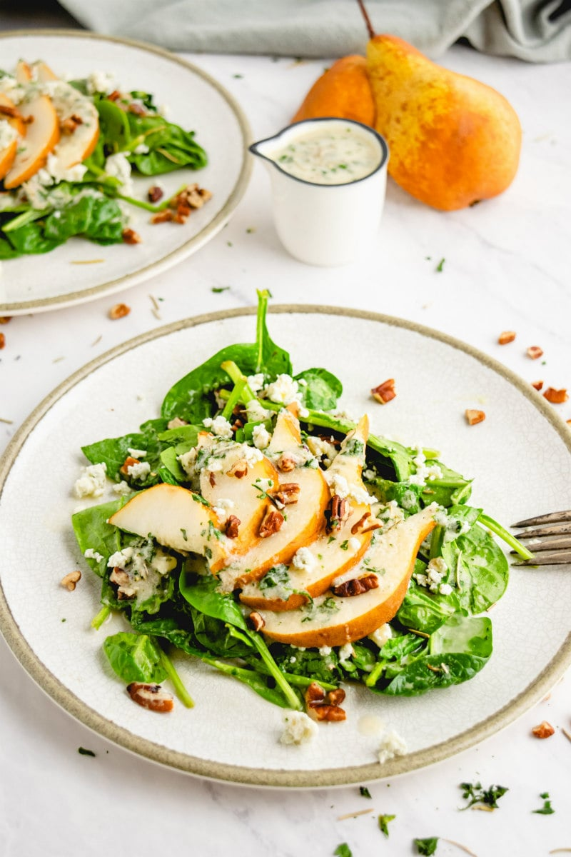 spinach and pear salad on plate