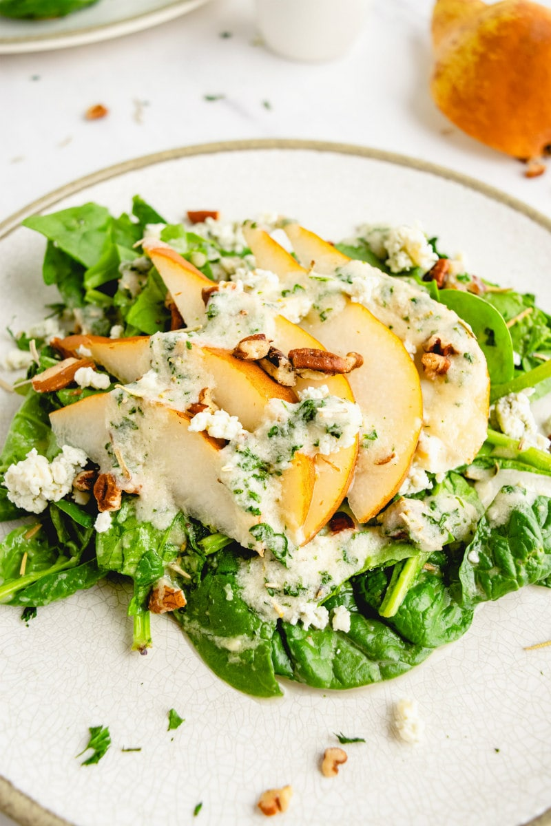 spinach and pear salad on white plate