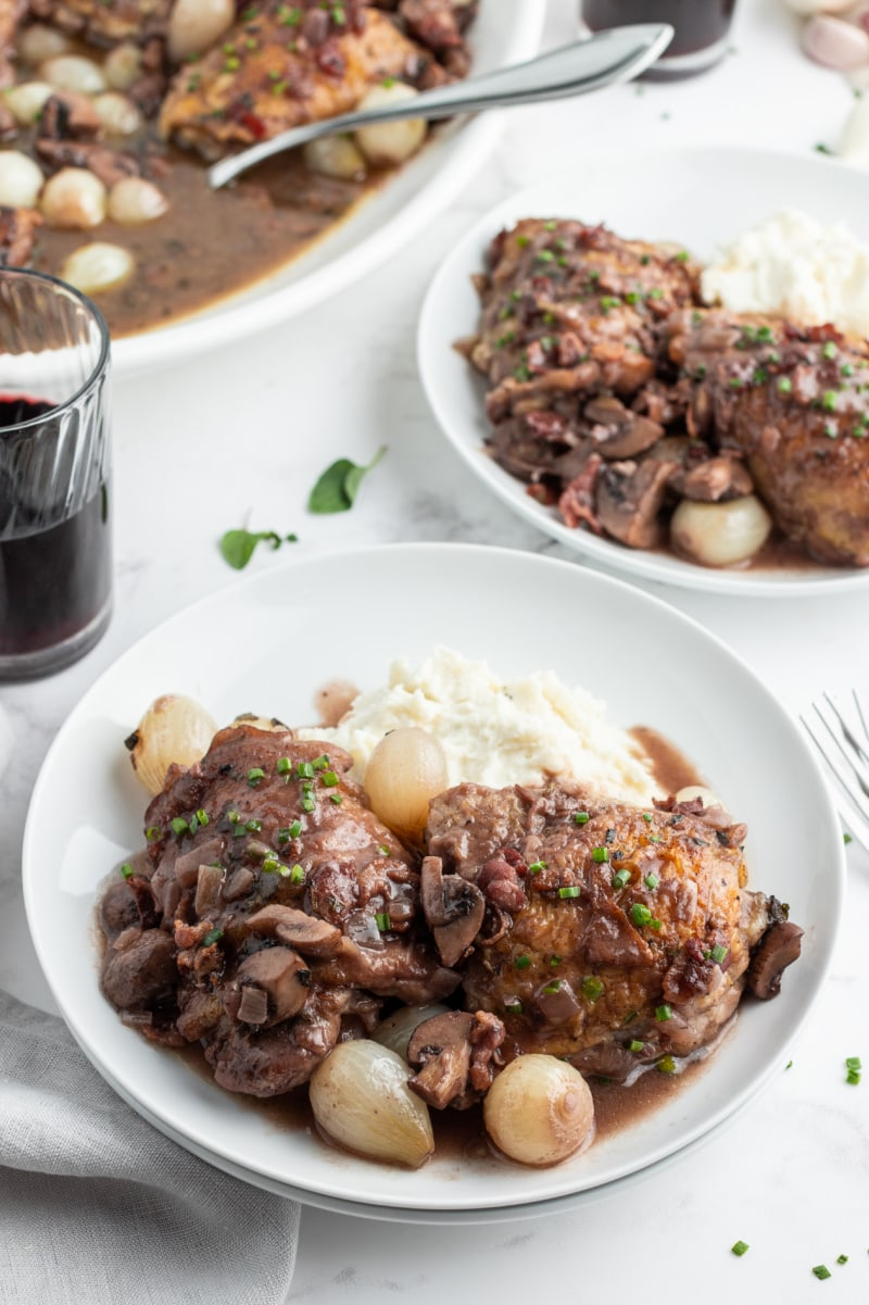 serving of coq au zin on white plates