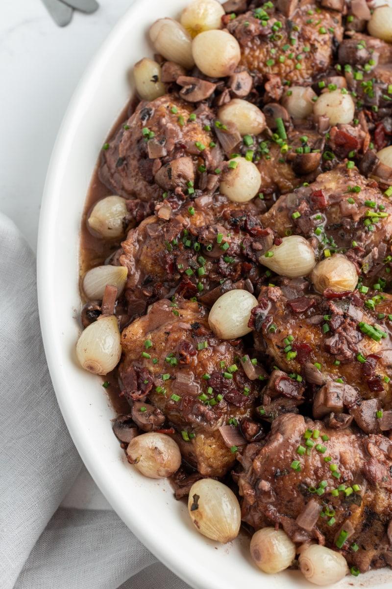 coq au zin in white serving dish