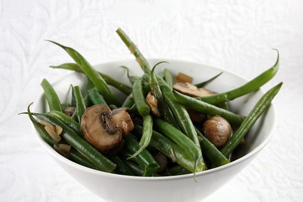 Green Beans with Mushrooms and Shallots in a white bowl