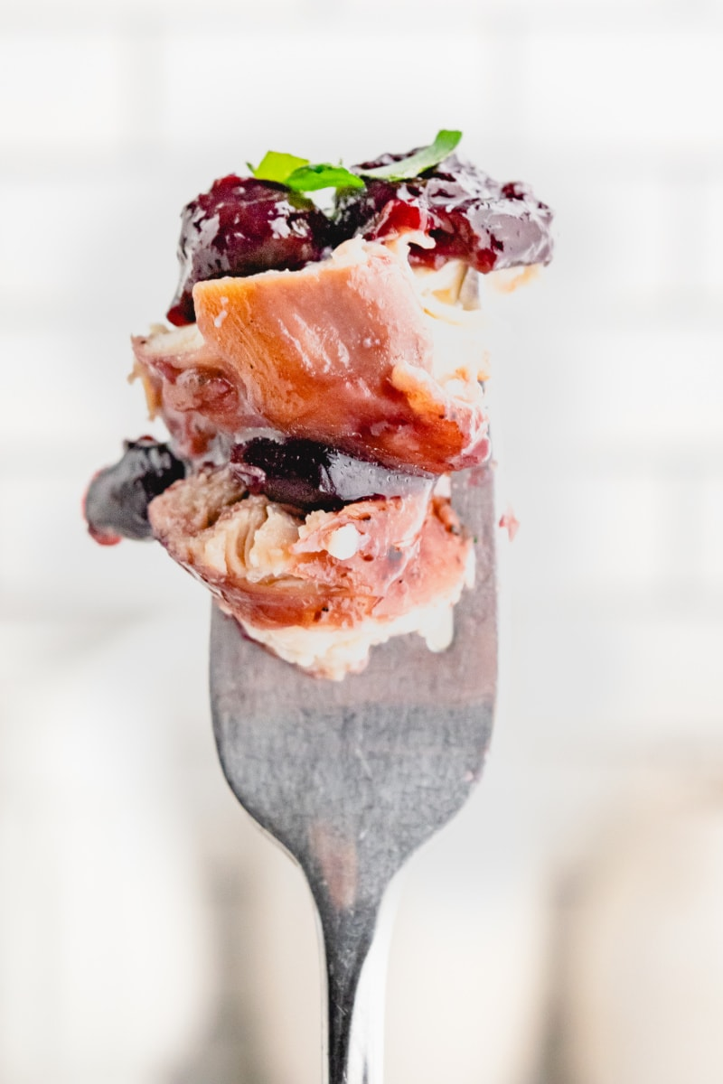 forkful of chicken with cherries