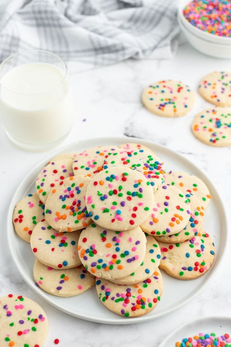 celebration cookies on a white plate