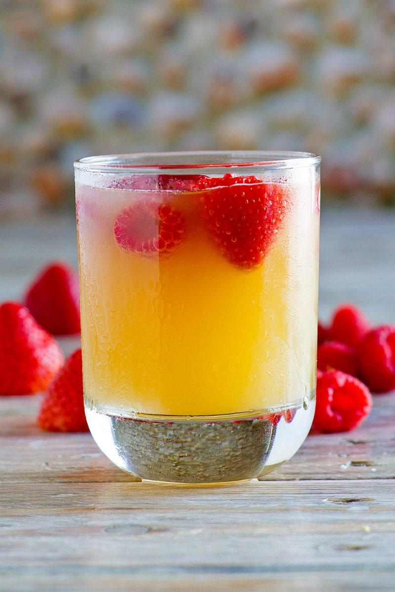glass of fruity vodka spritzer