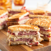 grilled reuben sandwiches on a cutting board