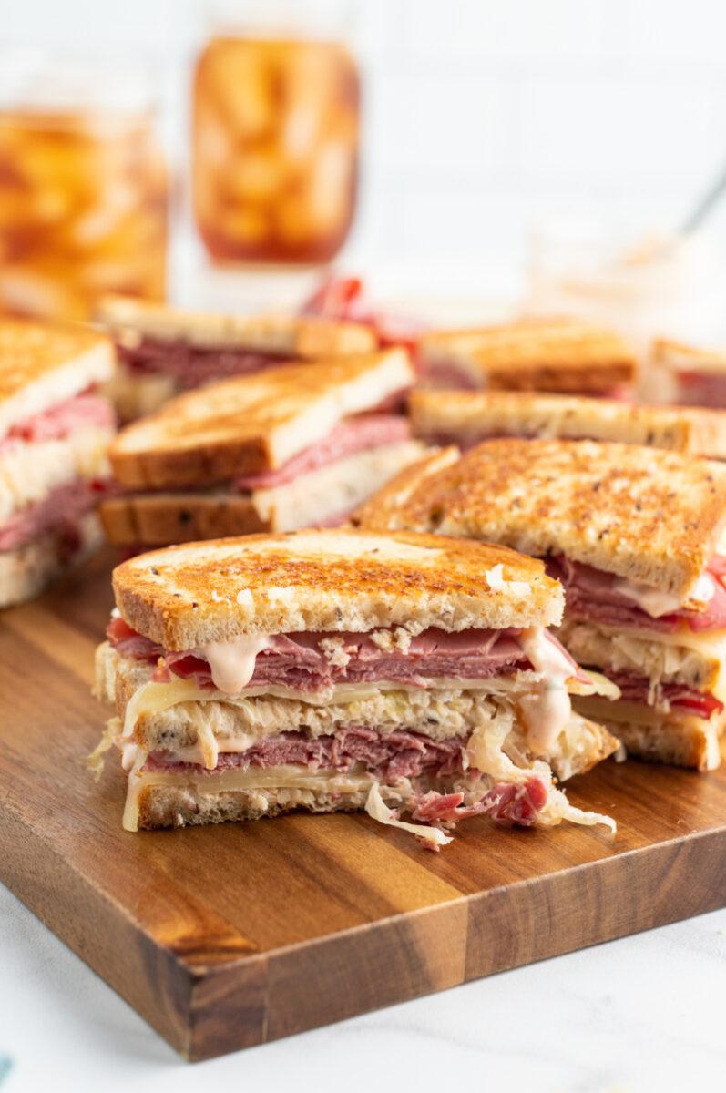 Grilled Ruben Sandwiches on a Cutting Board