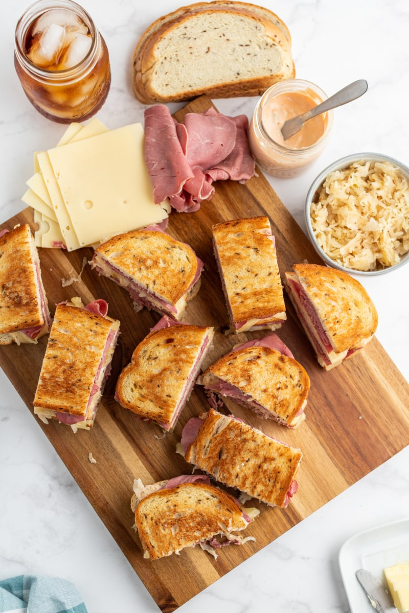 Overhead view of halved sandwiches on cutting board