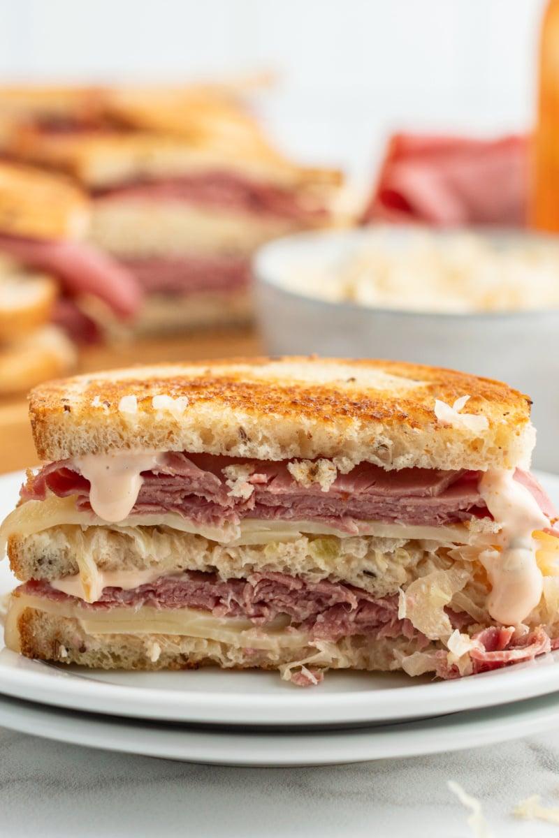 Ruben sandwich on a white plate