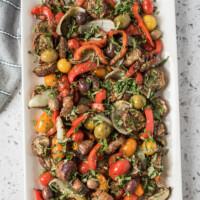 overhead shot of grilled vegetable salad on a rectangular white platter