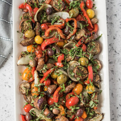 overhead shot of grilled vegetable salad on a rectangular white platter