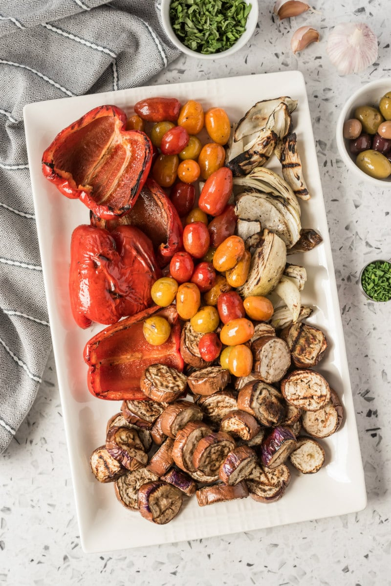 overhead shot of grilled vegetables on a rectangular white platter