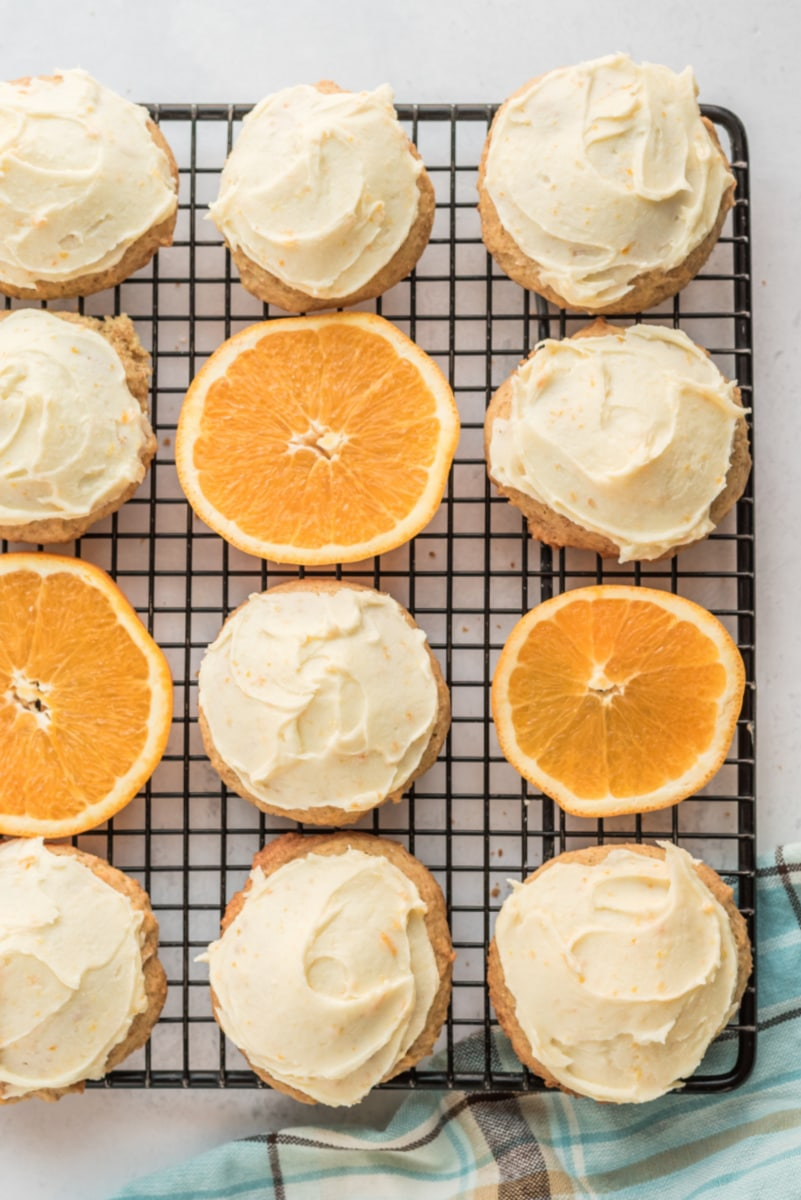 iced orange cookies on cooling rack