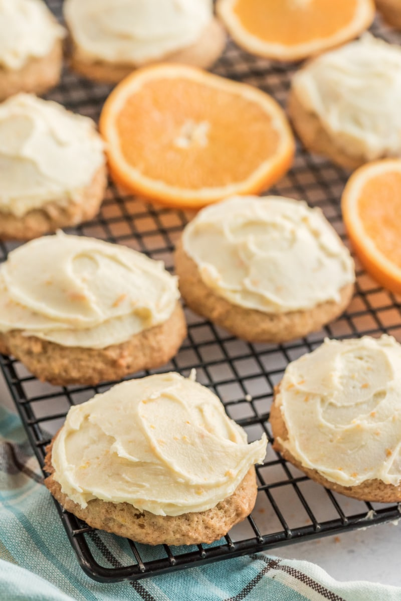 iced orange cookies on a cooling rack