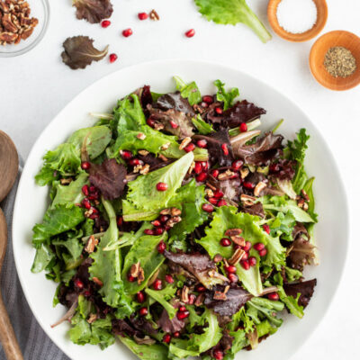 serving of mixed greens pomegranate salad