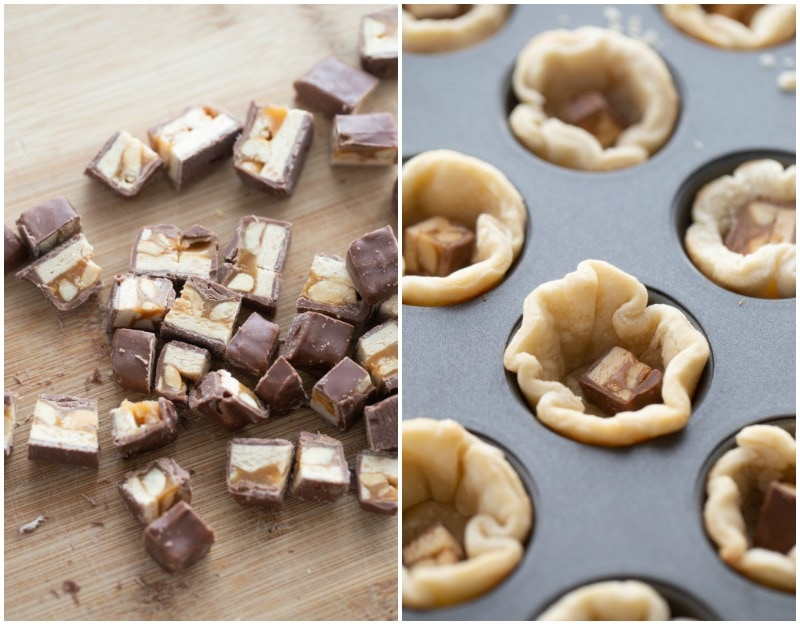 cut up snickers bars and pieces of them in pie dough muffin tin