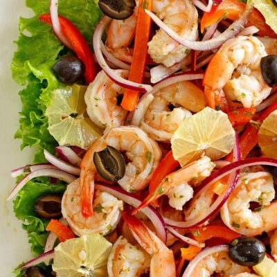 spicy lemon shrimp salad edged by lettuce leaves