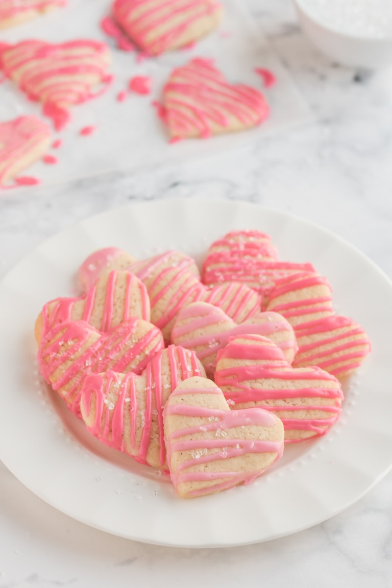 weight watchers heart shaped sugar cookies with pink glaze on platter