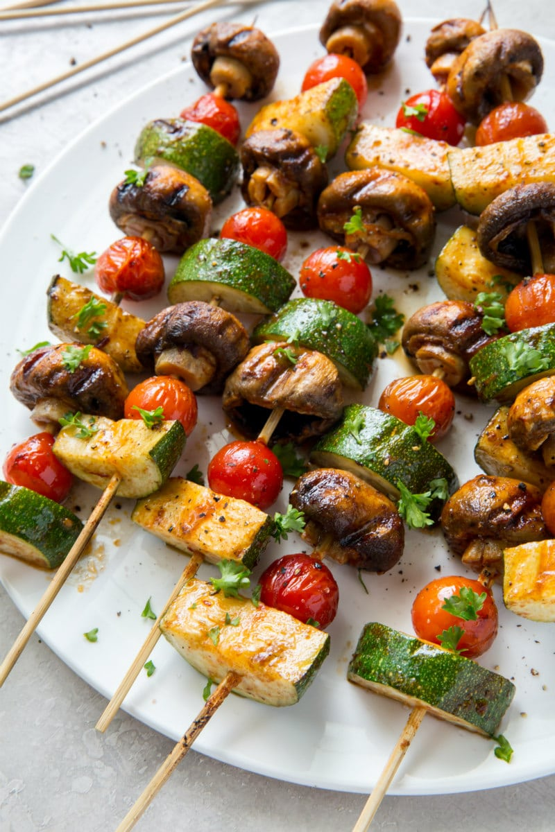 vegetable kabobs on a white platter