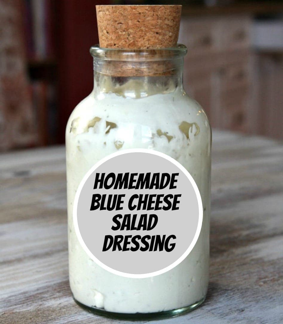 blue cheese salad dressing in a bottle with a cork.