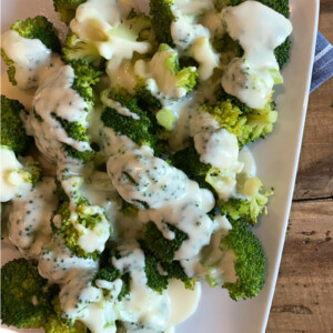 broccoli on a plate with cheese sauce