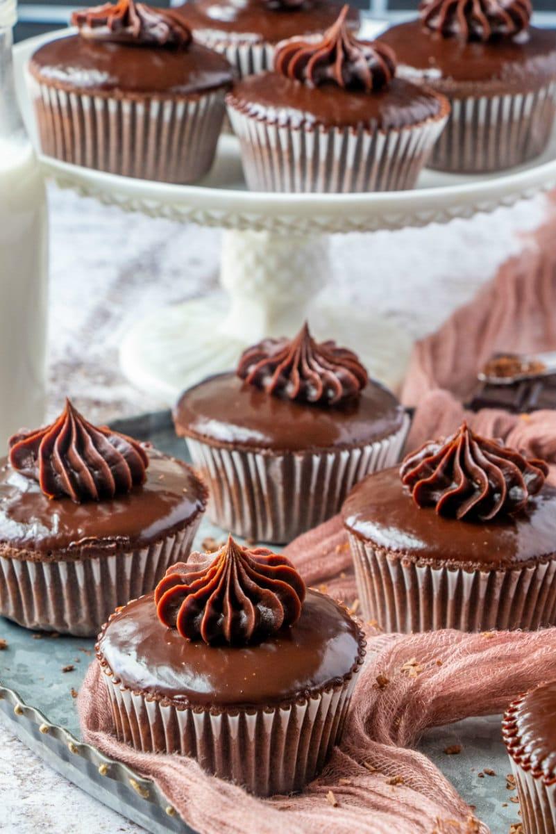 decorative display of chocolate ganache cupcakes
