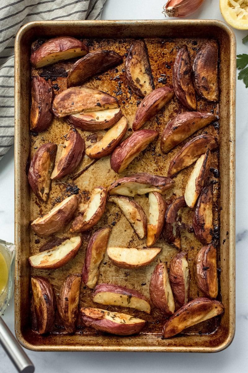 potato wedges on a baking sheet