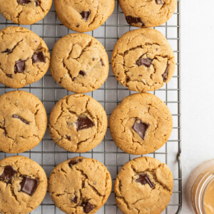 honey peanut butter chocolate chunk cookies on a cooling rack