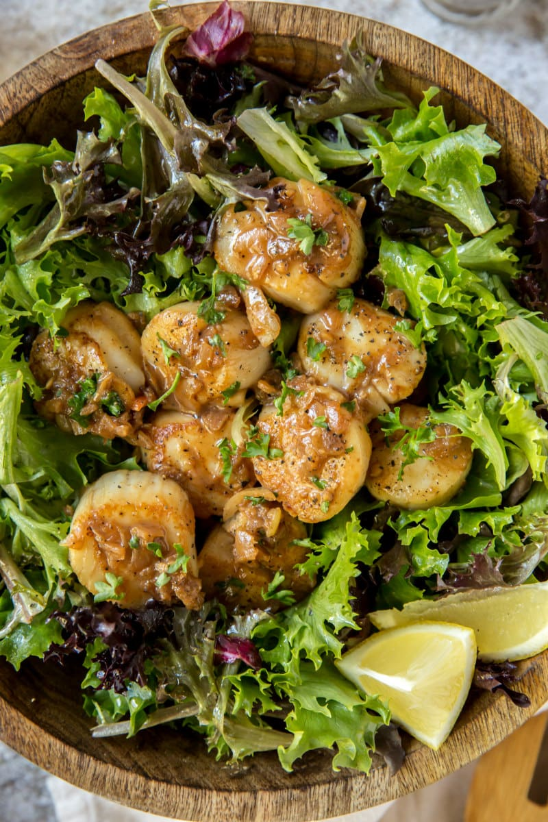 Lemon Scallops served over greens